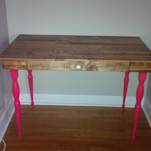 desk with pink legs